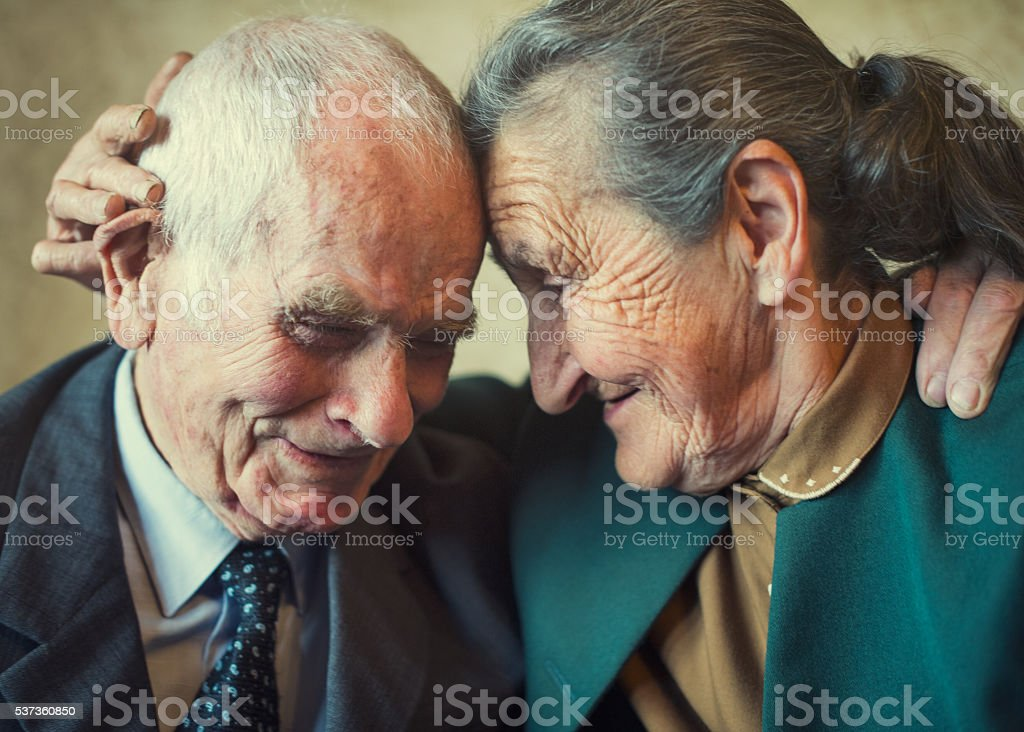 80 plus year old married couple posing for a portrait stock photo