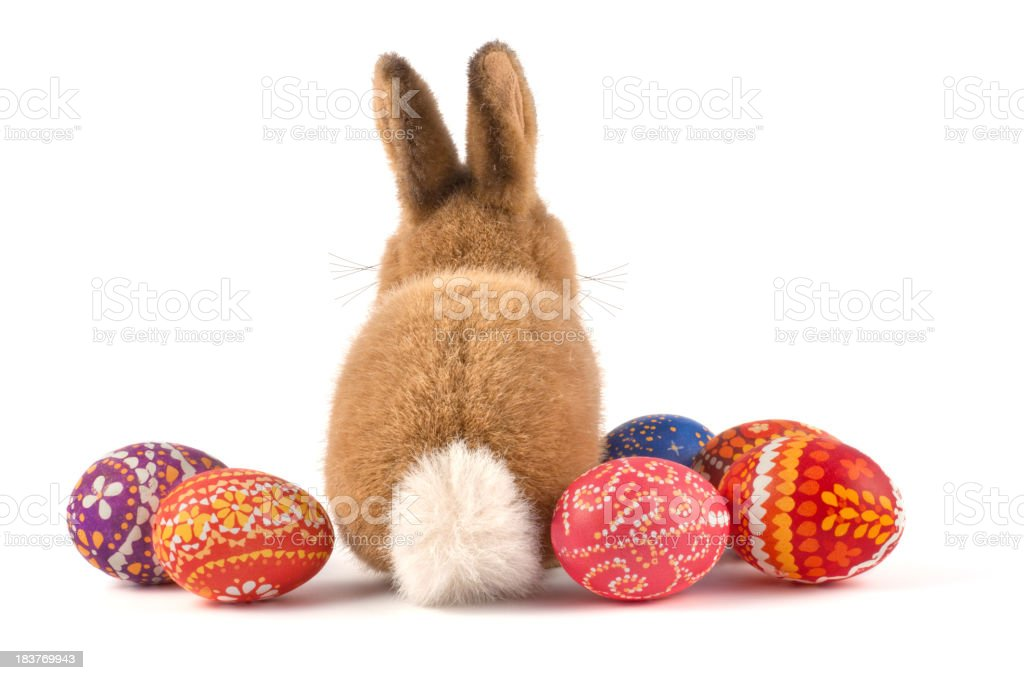 Plush Easter bunny and decorated Easter eggs stock photo