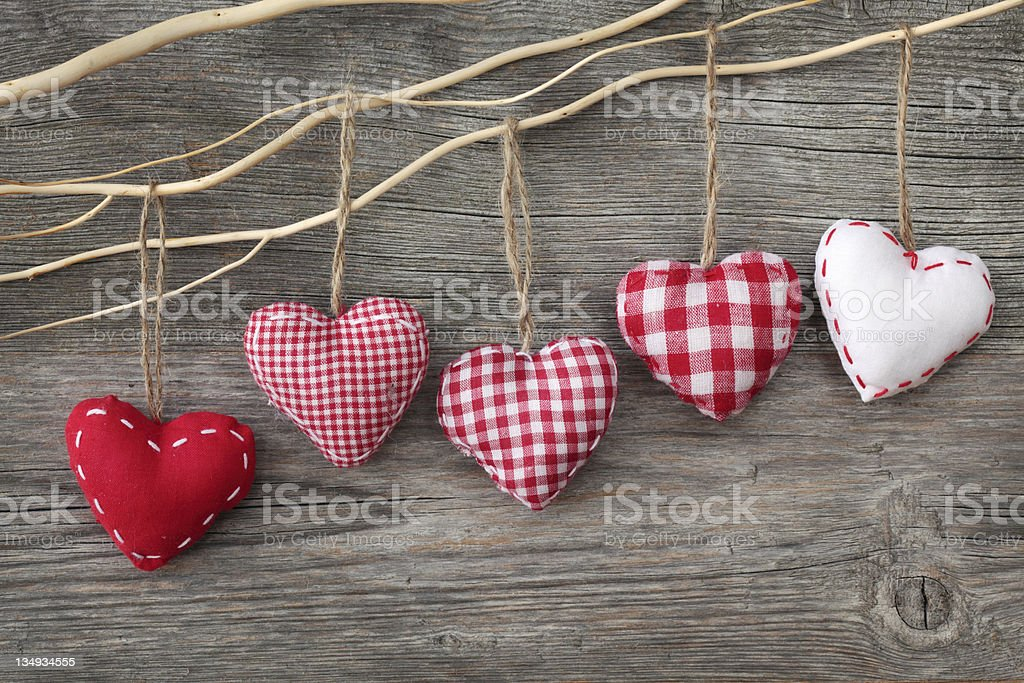 Plush red hearts hanging from branch royalty-free stock photo