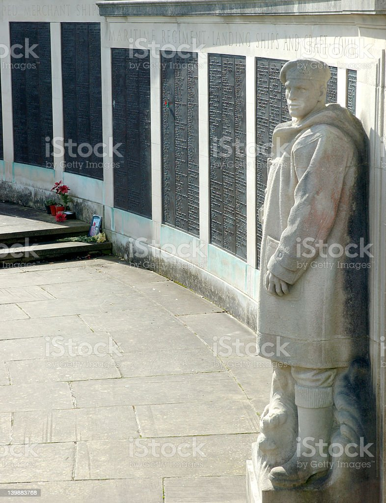plymouth war memorial with stone man stock photo