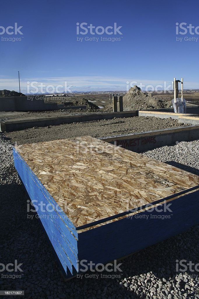 Plywood located at the empty job site. stock photo