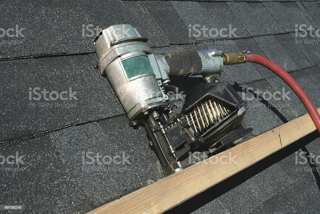 Pneumatic roofing nail gun stock photo