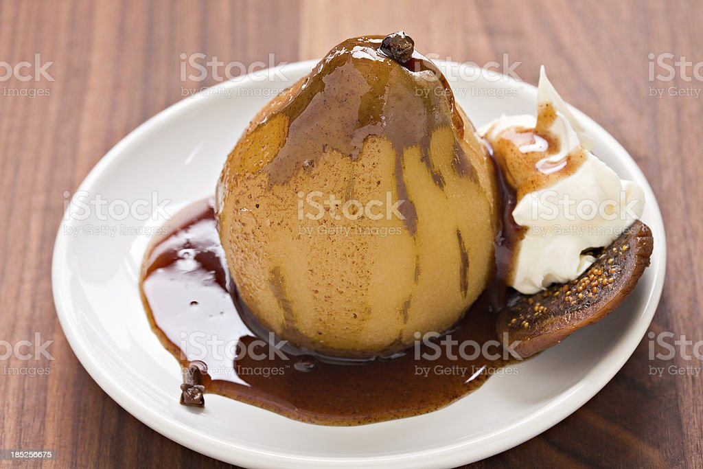 Poached Bosc Pear stock photo