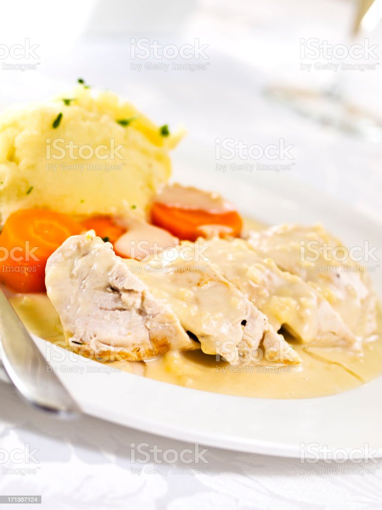 Poached chicken with white wine sauce stock photo