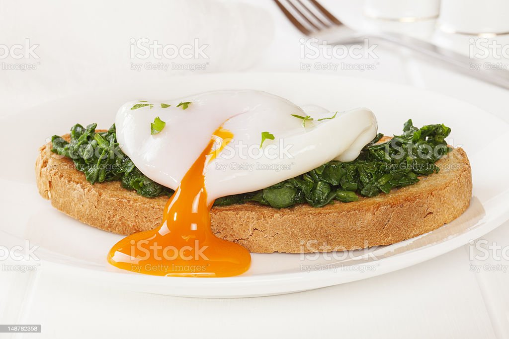 Poached Egg and Spinach on Toast stock photo