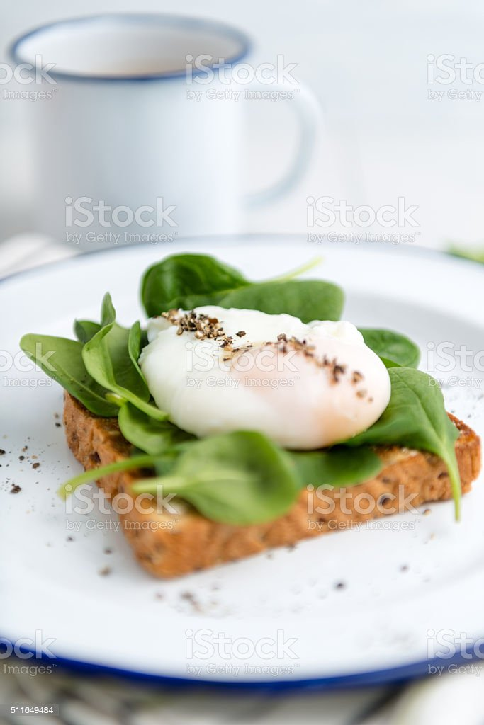 poached egg and spinach toast stock photo