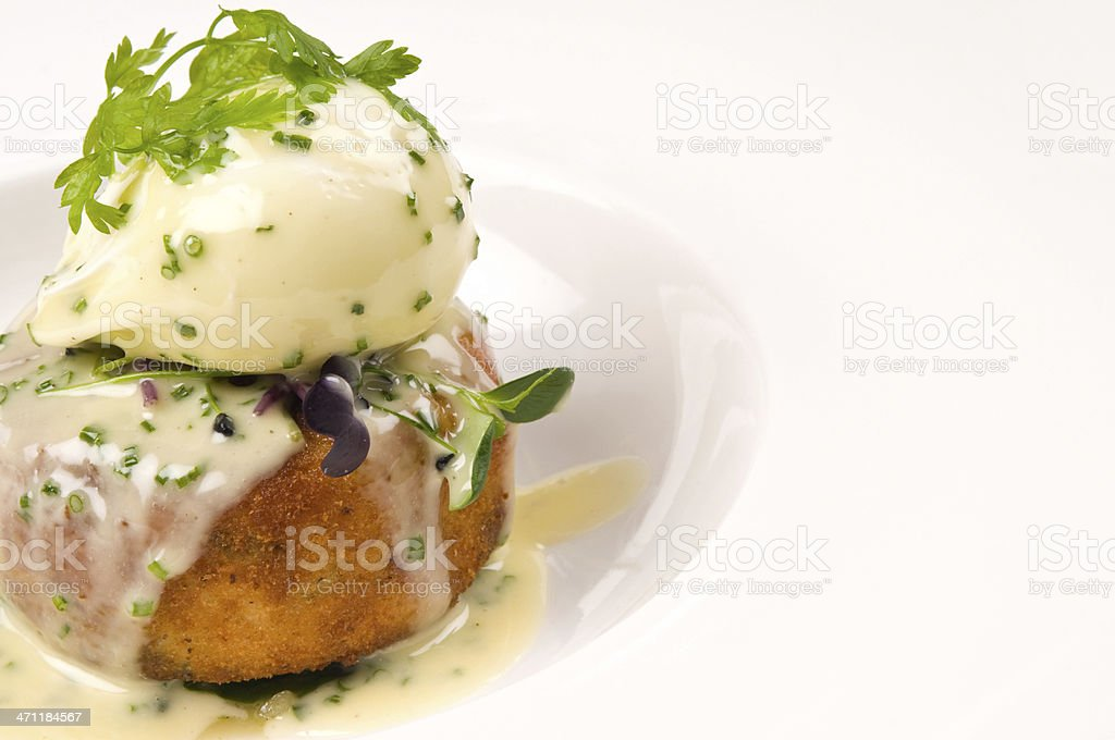 poached egg on fishcake royalty-free stock photo