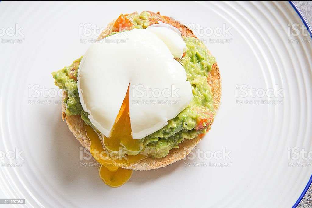 Poached egg with avocado stock photo