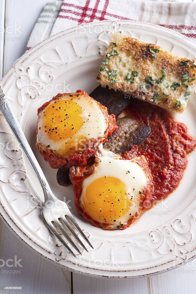 Poached Eggs With Red Sauce stock photo