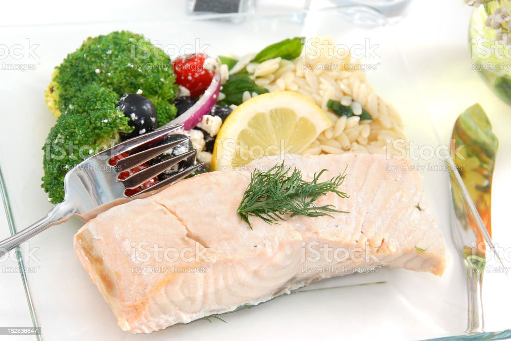 Poached salmon with lemon and seasoning royalty-free stock photo