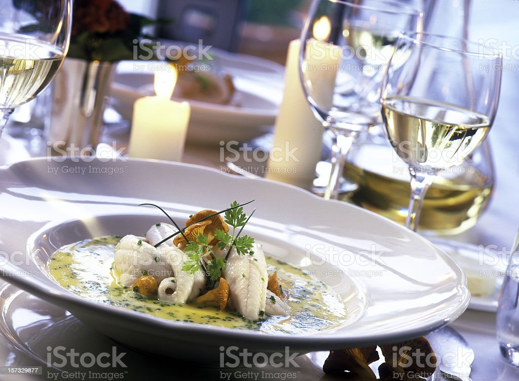 poached sole fillet and chanterelles stock photo