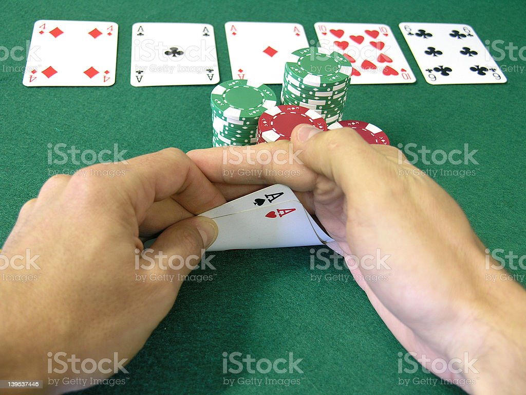 pocket aces plus 2 on the board royalty-free stock photo