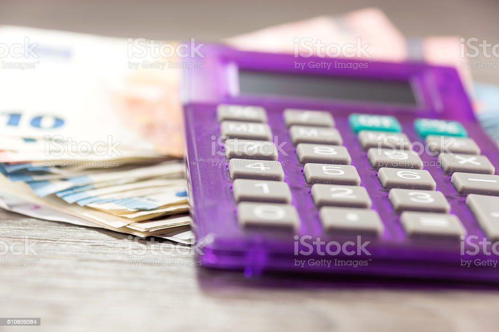 Pocket calculator and money stock photo