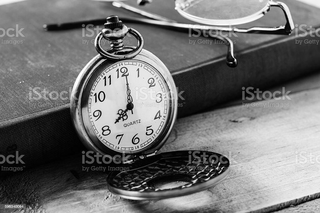 Pocket clock on books background stock photo