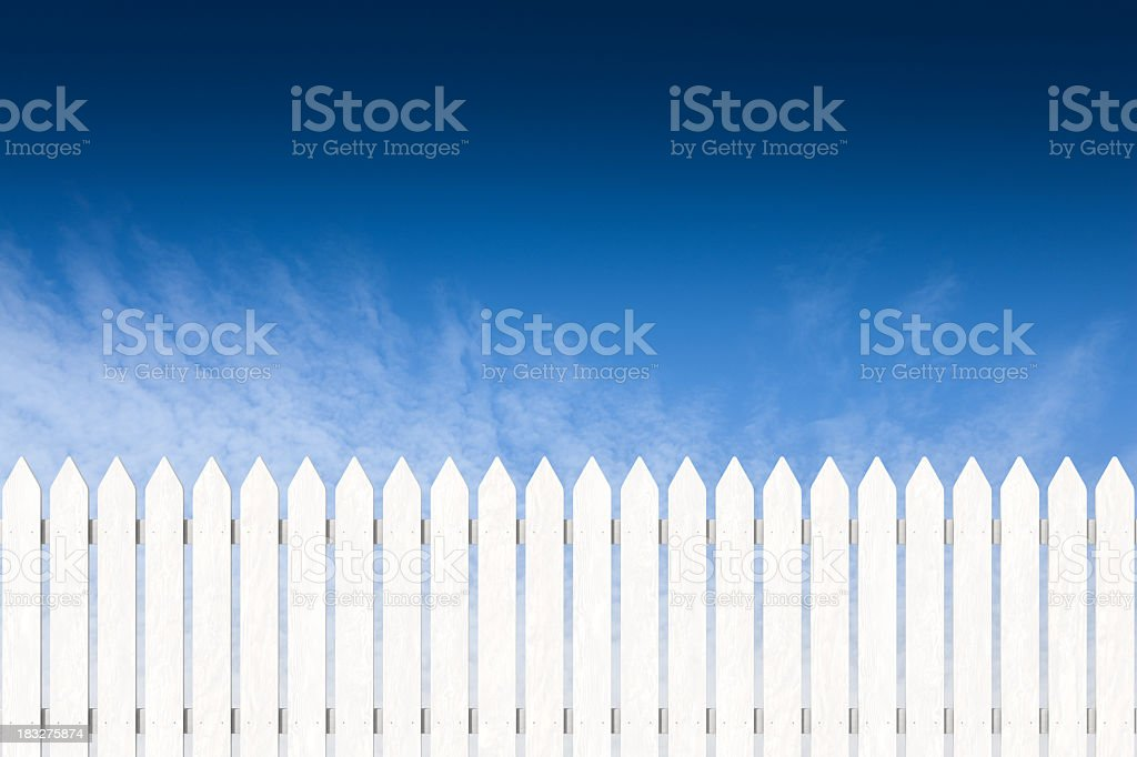 Pocket fence painted white with blue sky stock photo