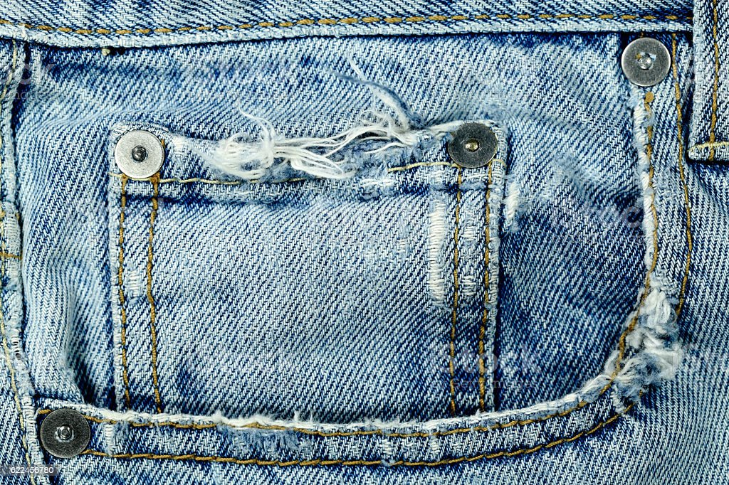 Pocket Frayed Old Distressed Worn Denim Jeans stock photo