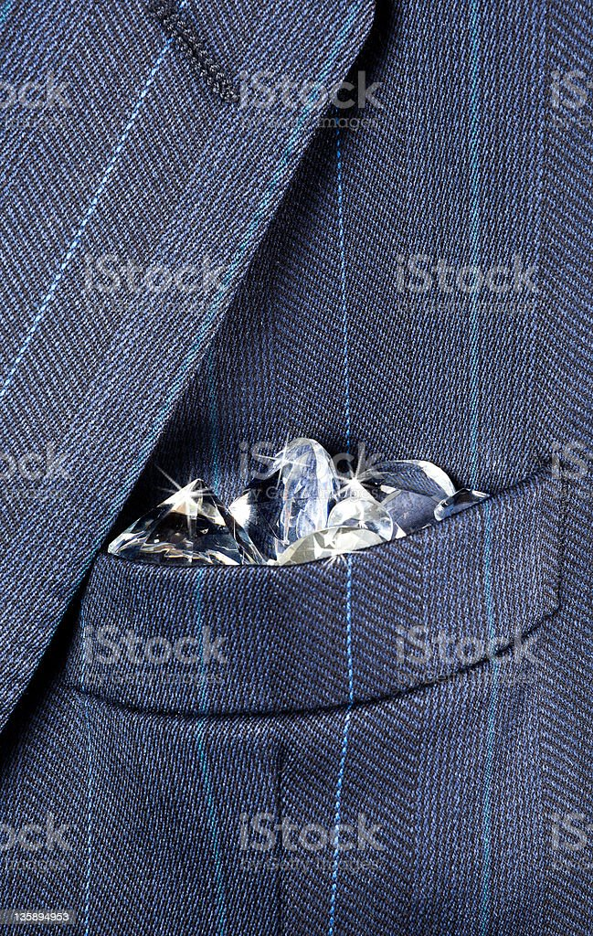 Pocket full of diamonds stock photo