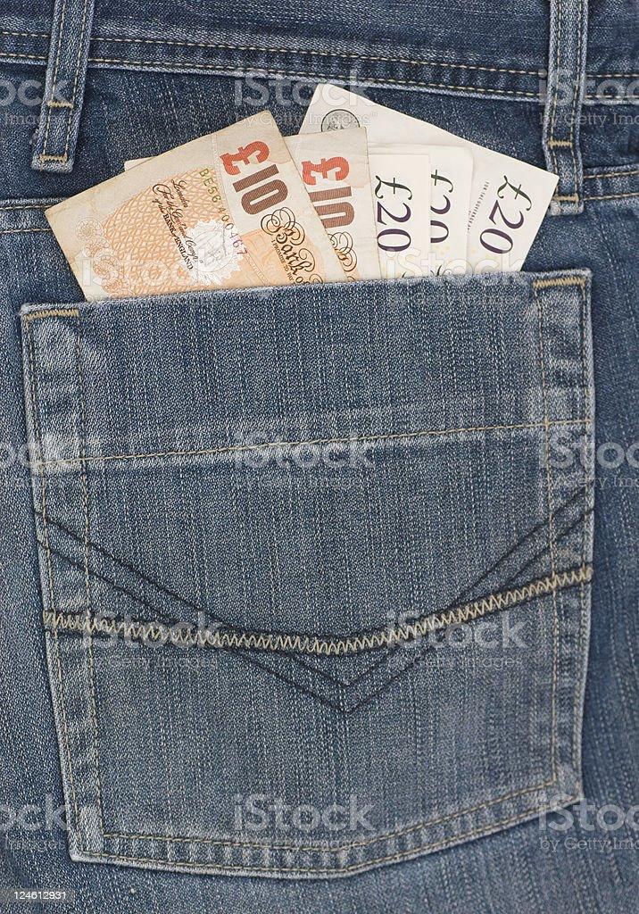 Pocket full of money stock photo