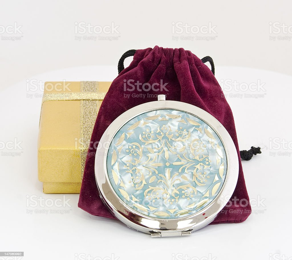 Pocket mirror as a gift on white background, isolated stock photo