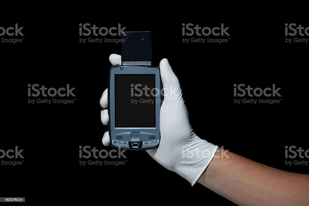 Pocket PC and Gloved Hand stock photo
