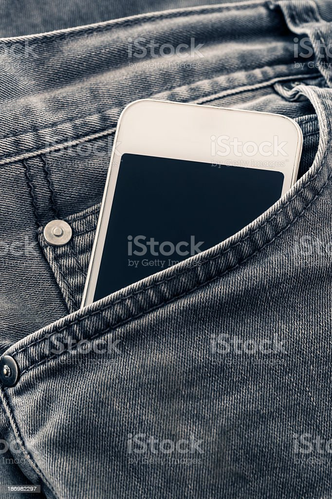 Pocket Phone Jean stock photo