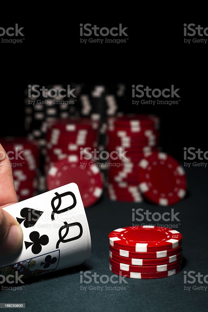 Pocket Queens with red & black poker chips royalty-free stock photo