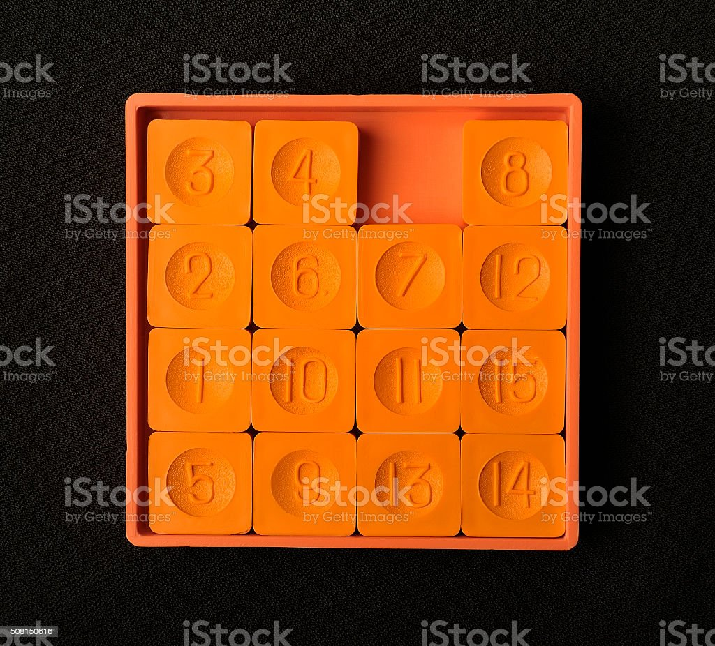 Pocket sliding fifteen puzzle game orange color stock photo