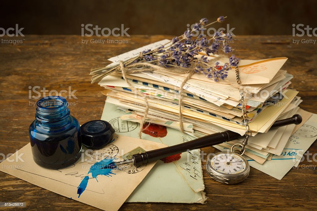 Pocket watch and old letters stock photo