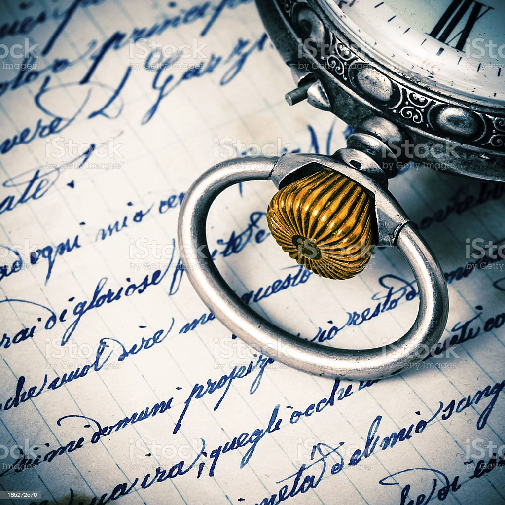 Pocket Watch Detail on Ancient Handwritten Text royalty-free stock photo