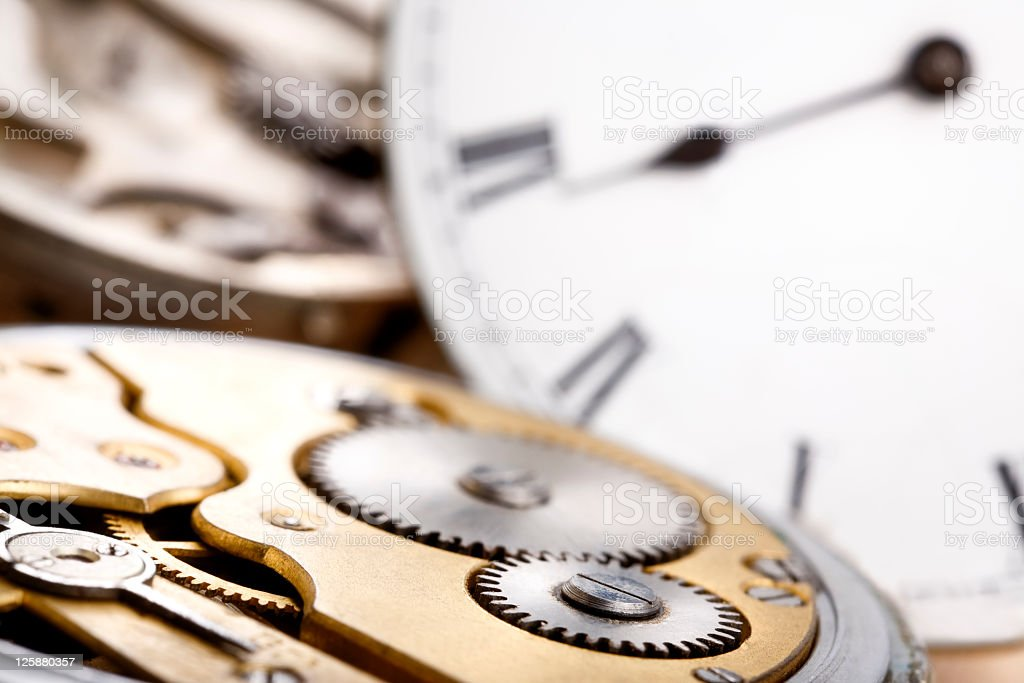 Pocket watch mechanism and clock face on background stock photo