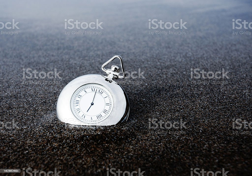 Pocket watch on a beach royalty-free stock photo