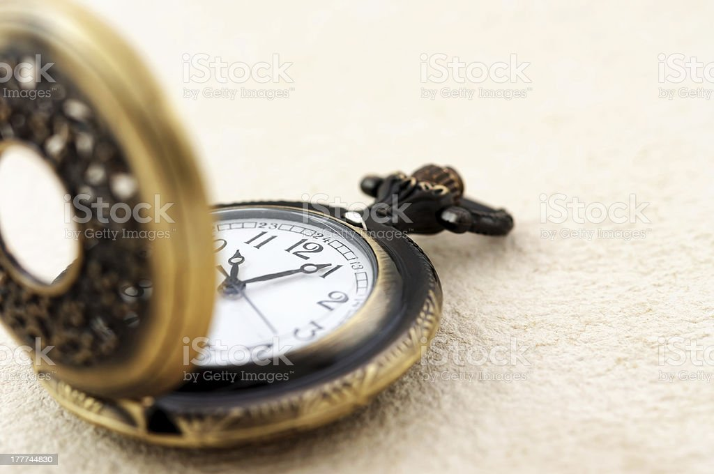 Pocket watch on vintage paper royalty-free stock photo