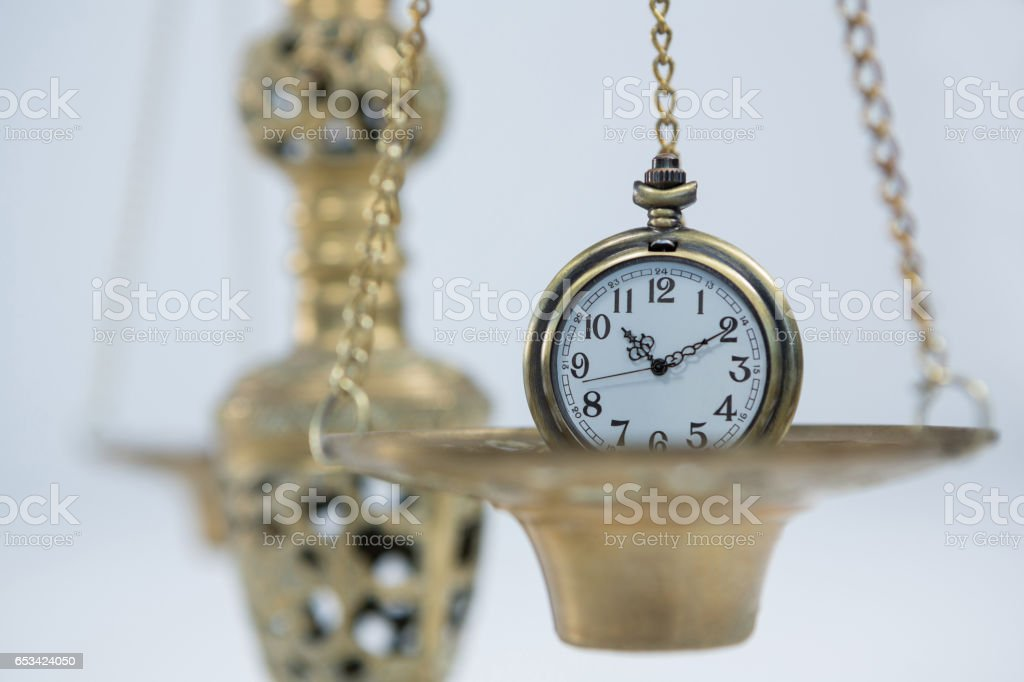 Pocket watch on weight scale stock photo