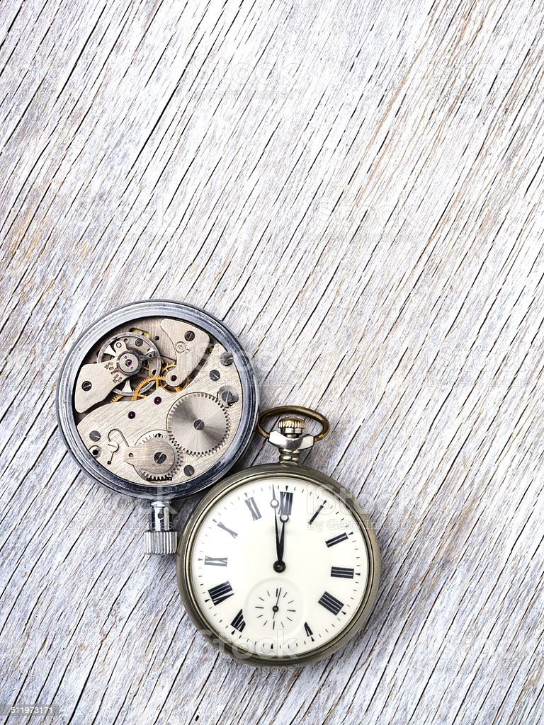 Pocket watch on wooden background stock photo