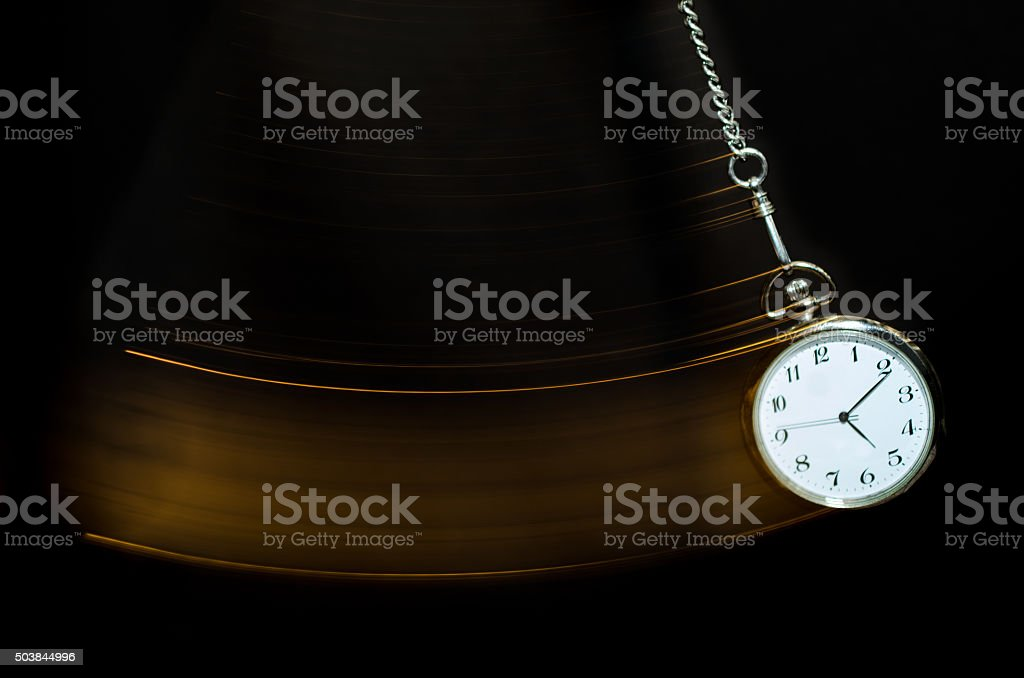 Pocket watch swinging stock photo