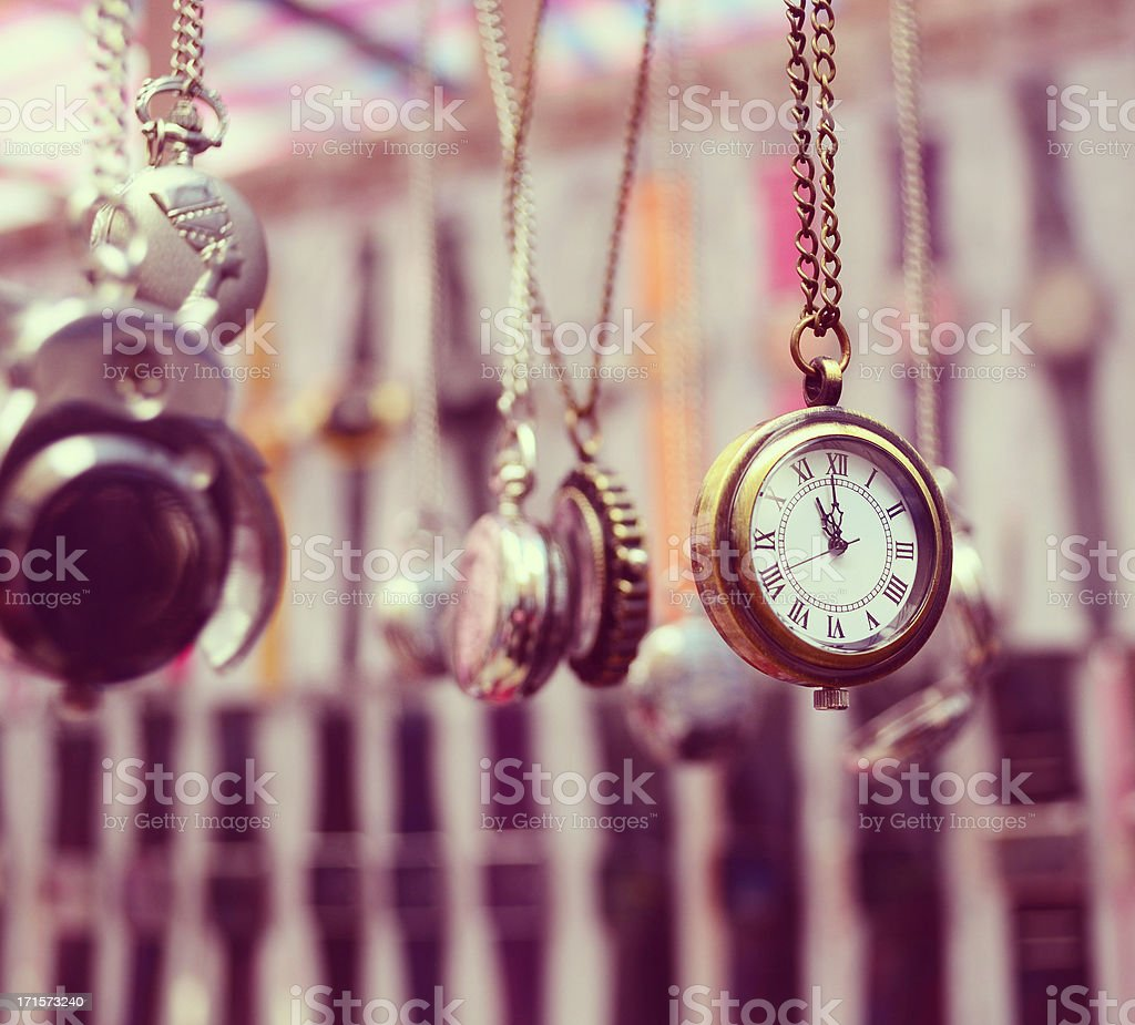 pocket watches hanging on chain stock photo