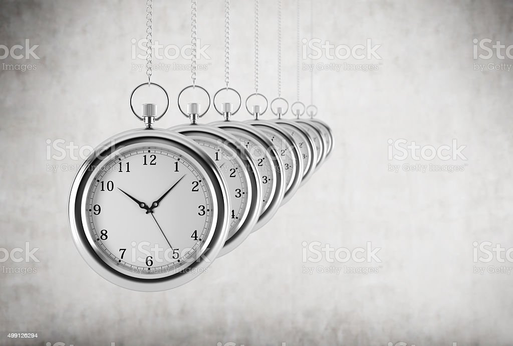 Pocket watches in a chain are in the line. stock photo