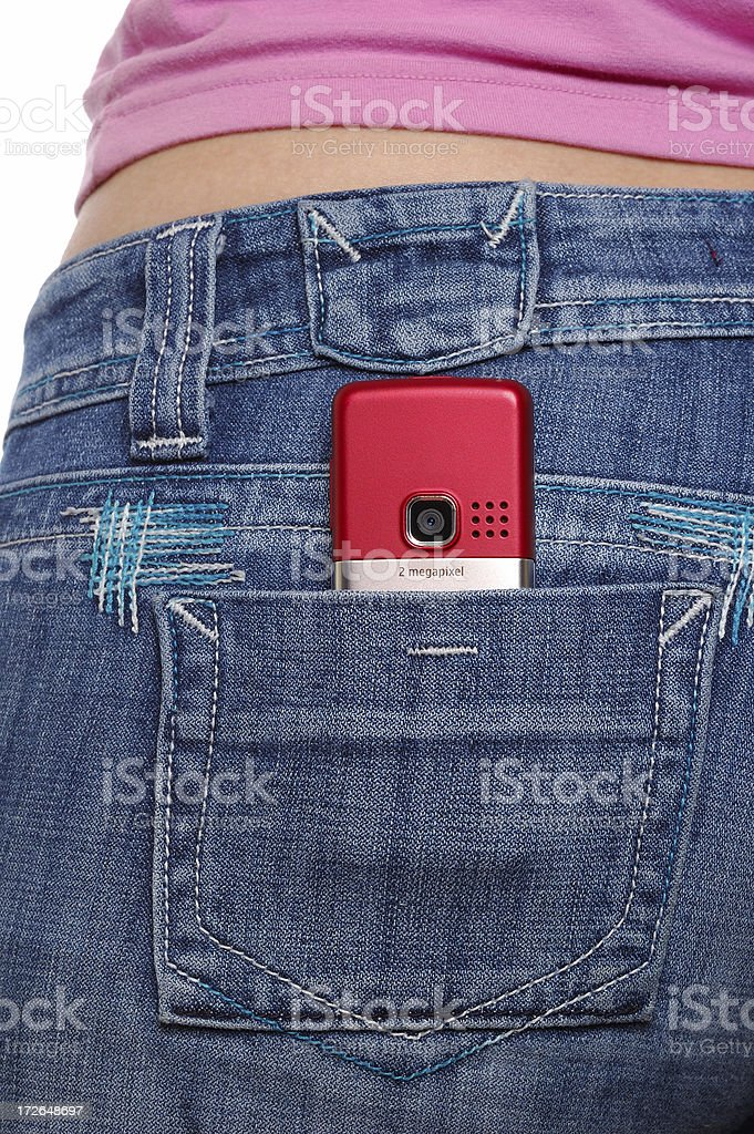 Pocket with cellular phone. Isolated on white stock photo