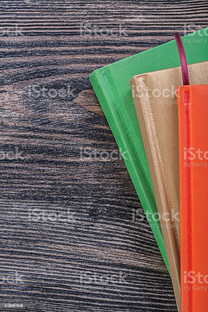 Pocket-books on vintage wooden board education concept stock photo