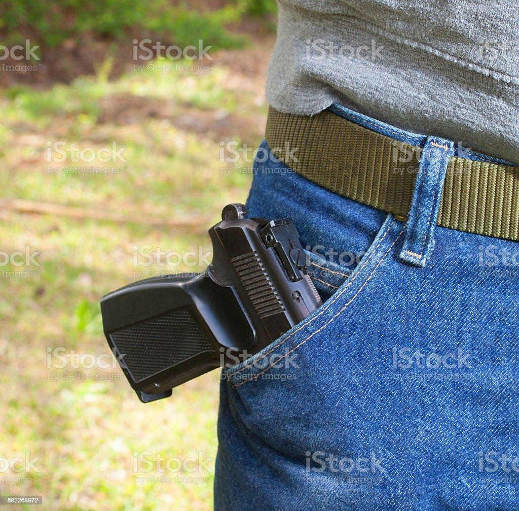 Pocketed handgun stock photo