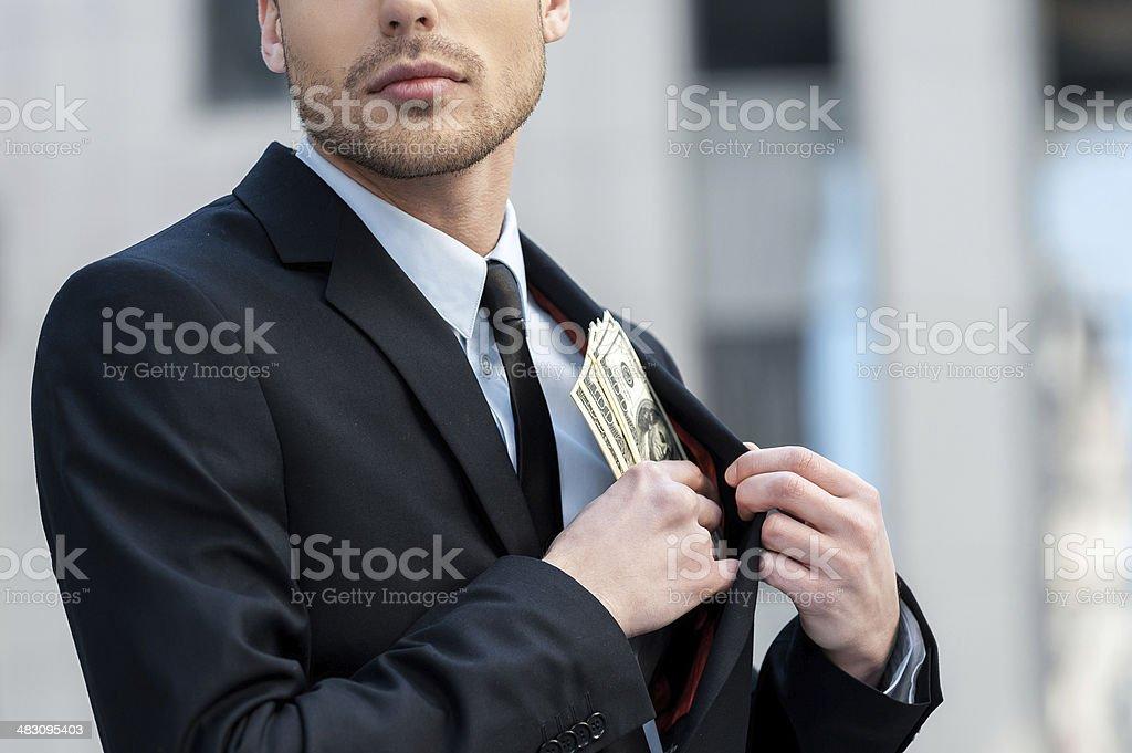 Pocketing company money. stock photo