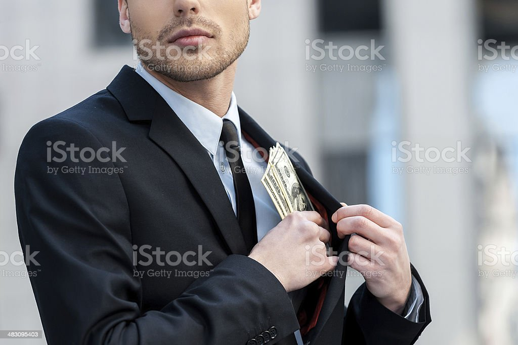 Pocketing company money. stock photo