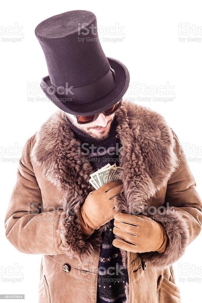 Pocketing dollars stock photo