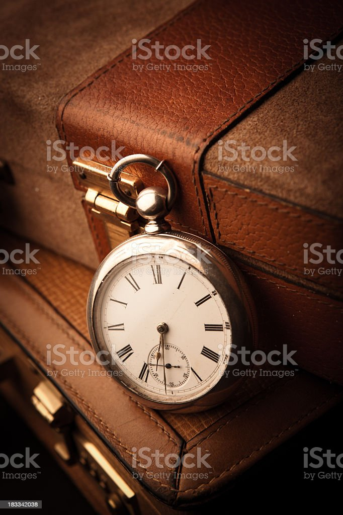 Pocketwatch and Briefcases stock photo