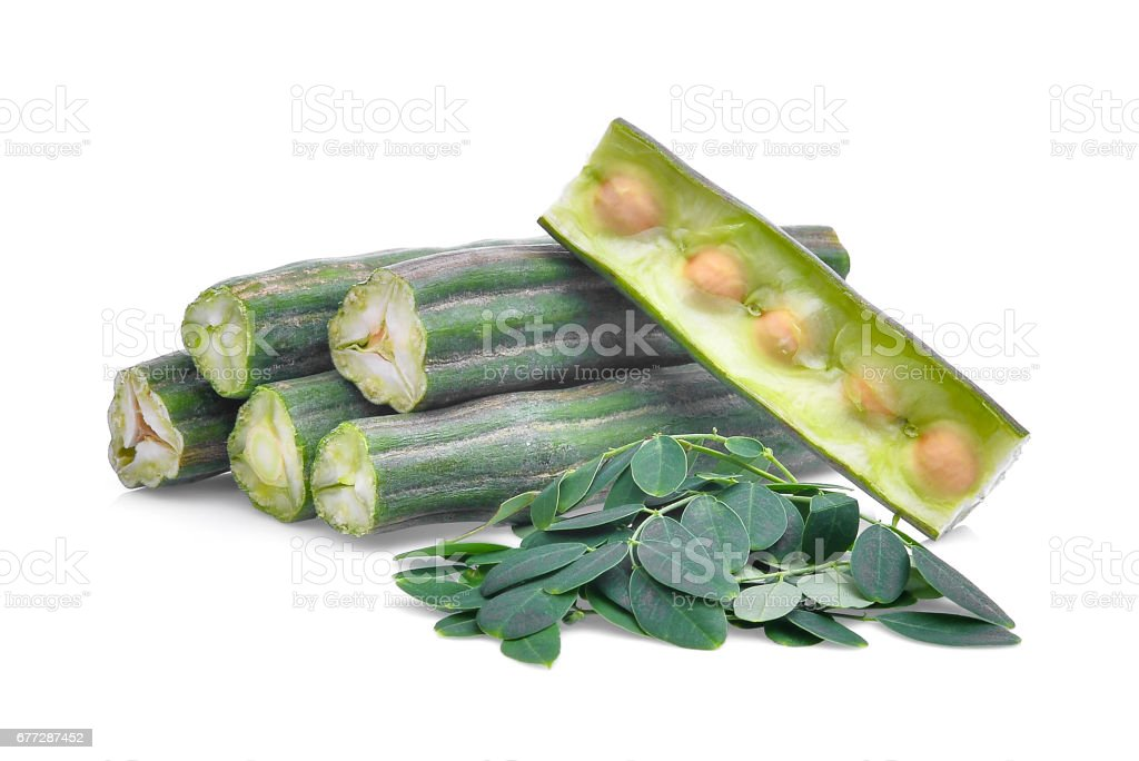 pod of  moringa (drumstick tree) with leaves isolated on  white background stock photo