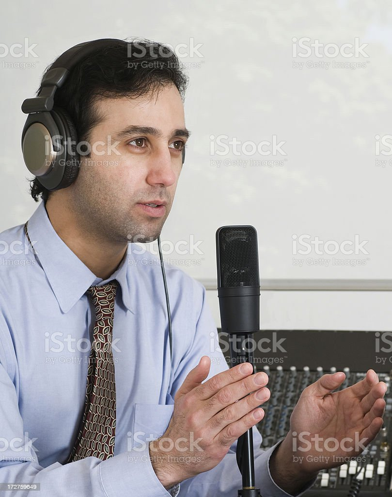 Podcaster Explaining royalty-free stock photo