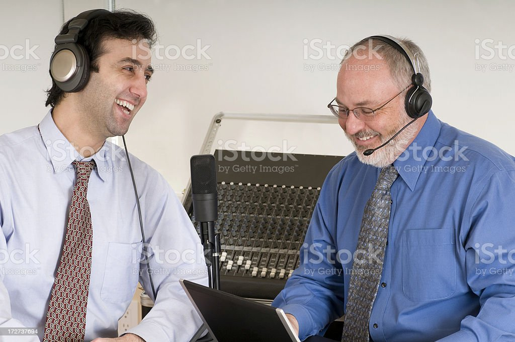 Podcasting Duo - Laughing royalty-free stock photo