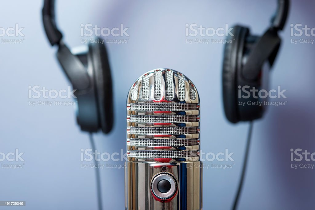 Podcasting mic and headphones stock photo
