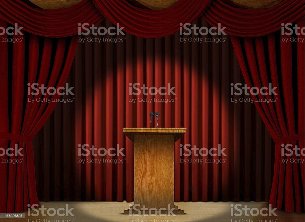 Podium in a spot light on stage over red curtains royalty-free stock photo