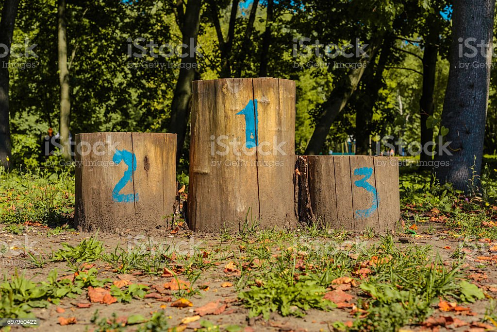 Olympic podium of the stumps in clearing in the autumn stock photo